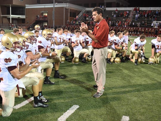 Mater Dei head coach Mike Goebel talks to his team after winning 21-20 in overtime as Evansville Mater Dei plays Owensboro High in the second game of a double header at the Independence Bank Border Bowl played at Rash Stadium in Owensboro, August 25, 2017.
