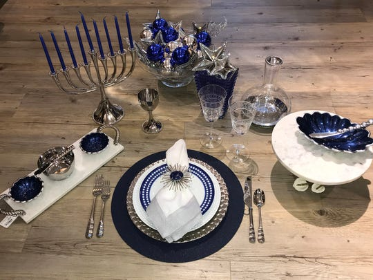 When setting a table for Hanukkah, start with blue and silver, as they are the traditional colors for the holiday. Serving pieces, which can be in white, should be plentiful and elegant to showcase traditional foods.