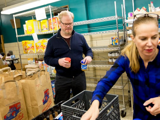 Actor and comedian Jim Gaffigan and his wife, Jeannie, sort food donations at the Riverwest Food Pantry in Milwaukee in 2016.