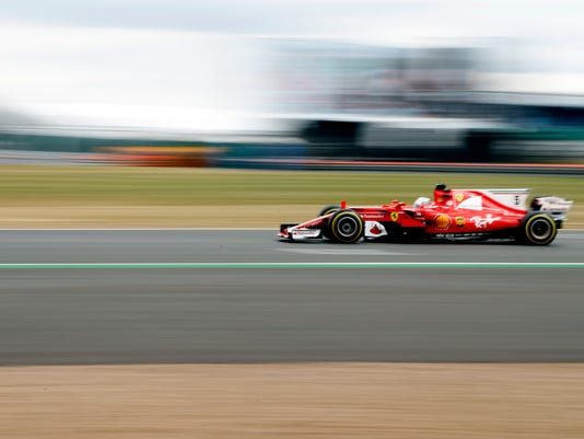 Ferrari driver Sebastian Vettel of Germany steers his car during the second free practice at the British Formula One Grand Prix at the Silverstone racetrack, Silverstone, England, Friday, July 14, 2017. The British Formula One Grand Prix will be held on Sunday, July 16. (AP Photo/Frank Augstein)