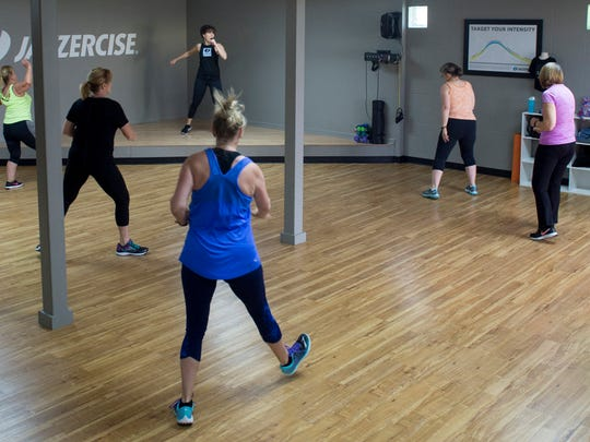 JoAnn Luttrell, top center, leads the 8 a.m. Dance Mixx Jazzercise class at the Jazzercise Newburgh Center Tuesday morning.