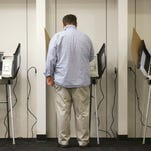 In this Nov. 3, 2015, file photo, a person votes, in Salt Lake City. Utah voters this month will pick candidates in key races for governor and U.S. Senate and narrow the field in dozens of other races. More than two-thirds of Utah counties are conducting the June 28 primary election mostly by mail.