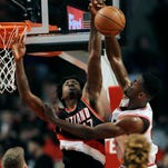 Portland Trail Blazers' Ed Davis (17) blocks the shot of Chicago Bulls' Bobby Portis (5) during the first half of an NBA basketball game Saturday, Feb. 27, 2016, in Chicago. (AP Photo/Paul Beaty)