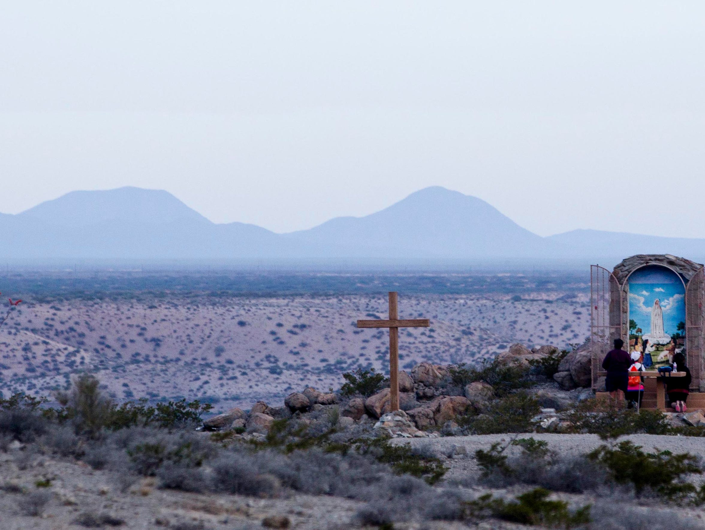 Catholic pilgrims hike up Mount Cristo Rey to pray