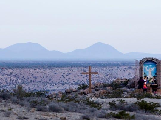 Catholic pilgrims hike up Mount Cristo Rey to pray and celebrate their faith on Good Friday 2017.