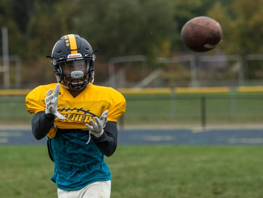 Steven Mason catches a pass during practice Wednesday,