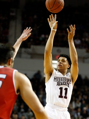 Mississippi State's Quinndary Weatherspoon (11) attempts to shoot past Eastern Washington during the first half Friday night.