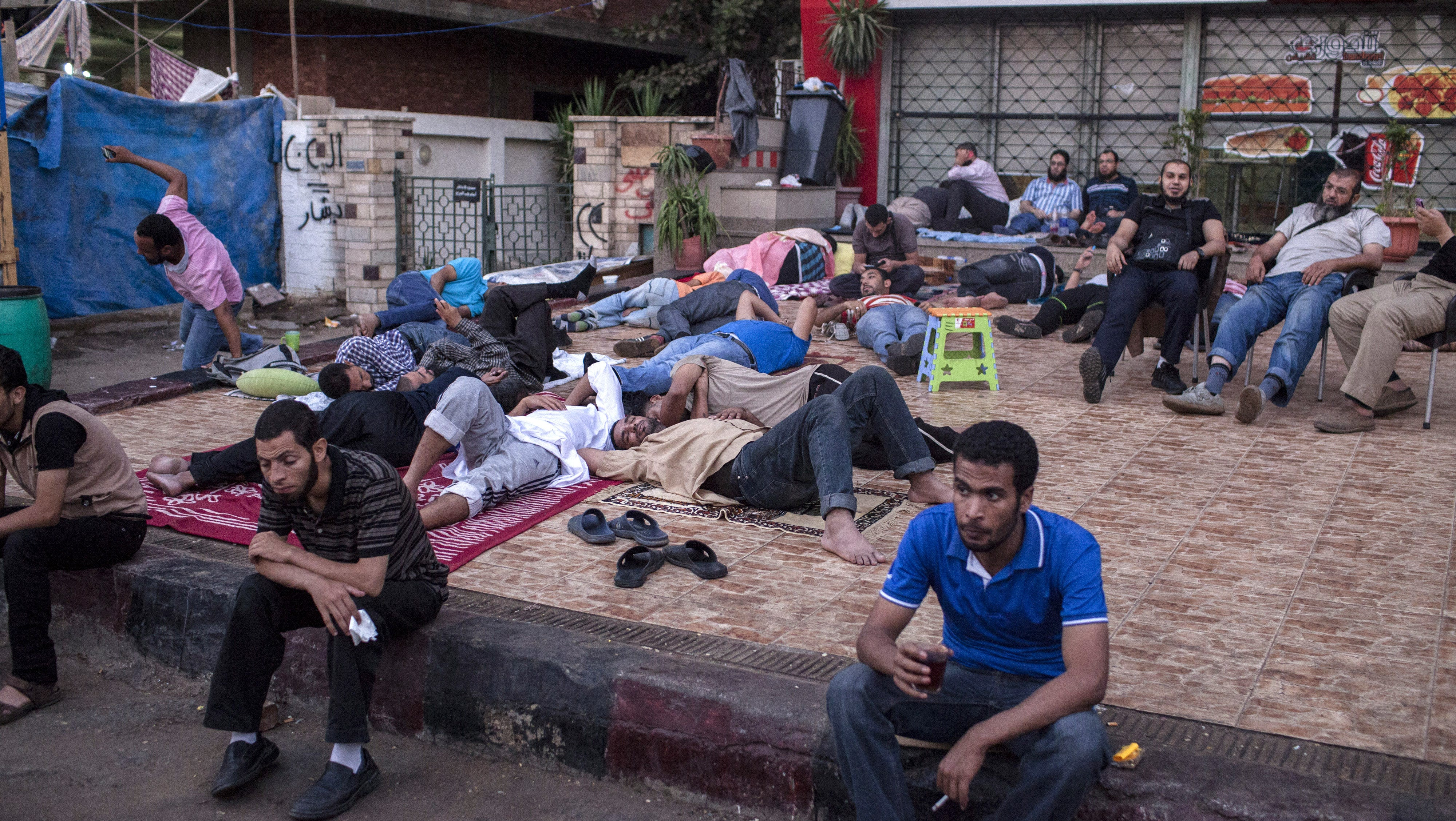 Morsi supporters attend a sit-in demonstration near the Rabaa al-Adweya Mosque in Cairo. Egyptian security forces have threatened a siege of pro-Morsi protest camps.