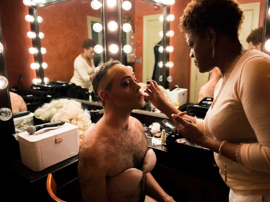 Dito van Reigersberg has his makeup touched up by stylist Kimberly Max Brown before a Martha Graham Cracker Cabaret show Thursday, March 9 at L'Etage in Philadelphia.