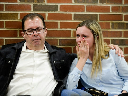 Steve McDonald and his daughter Devon McDonald, 18, of Marlton, become emotional as they discuss the loss of their daughter and sister, 15-year-old Madison McDonald, following a detention hearing for Austin F. Cooper, 21, of Willingboro Wednesday, April 18, 2018 at Burlington County Superior Court in Mount Holly, N.J. Cooper, who is charged with strict liability for an opioid-induced death of Madison McDonald, will remain detained until trial.