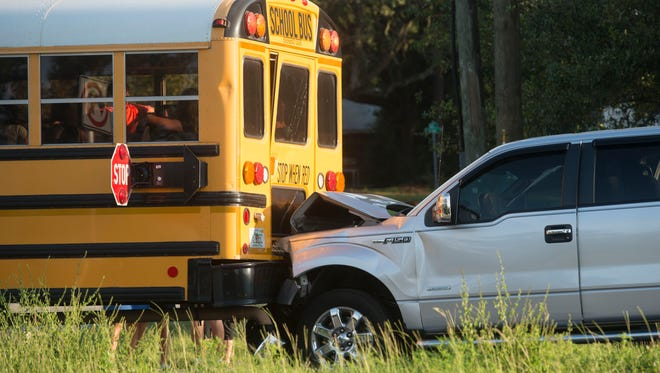 A Pensacola Christian Academy bus traveling west on Hwy 98 near the Pensacola Naval Hospital was rear-ended by a Ford pickup Wednesday morning. A third vehicle involved in the accident slammed into the pickup.