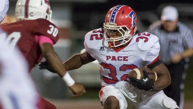 Anthony Johnson Jr. (32) carries the ball during the Pace vs Tate football game at Tate High School on Friday, October 7, 2016.