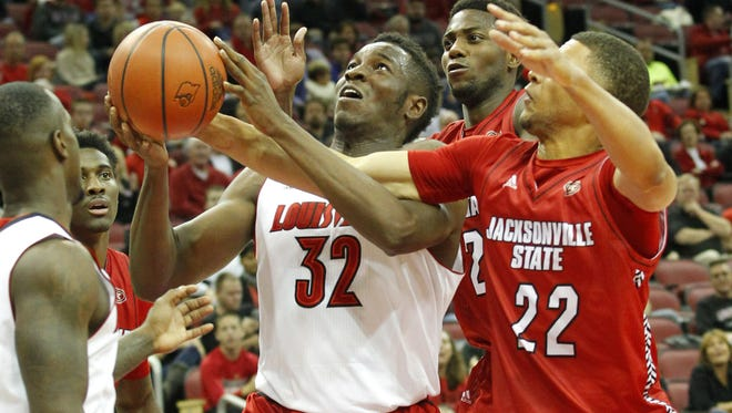 University of Louisville's Chinanu Onuaku (32) fights for the loose ball with Jacksonville State's Jamal Hunter (22) during a 2014 game between Louisville and Jacksonville State.