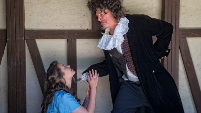 """Sarah Holt and David Mycoff as Wendy Darling and Captain Hook in the Montford Park Players' rendition of """"Peter Pan."""""""