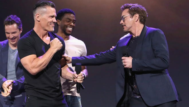 Josh Brolin, left, and Robert Downey Jr. jokingly face off at D23, but their characters throw down in epic fashion in 'Avengers: Infinity War.'