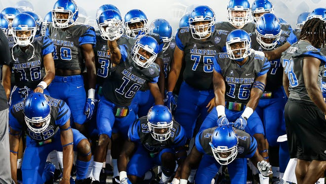 University of Memphis football team prepare to take the field as they take on Southern Illinois University at the Liberty Bowl Memorial Stadium Saturday, September 23, 2017.
