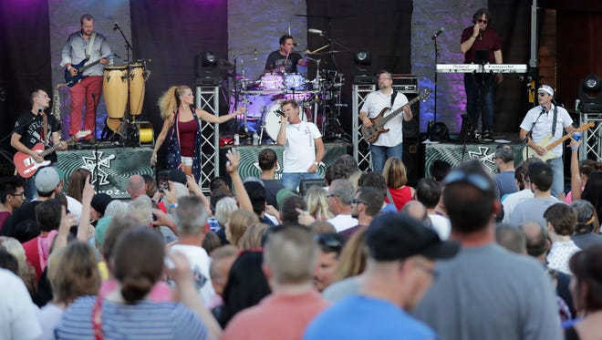 Boogie and the Yo-yo'z perform before the annual Festival Foods Fireworks on Tuesday, July 3, 2018 at Memorial Park in Appleton, Wis.Wm. Glasheen USA TODAY NETWORK-Wisconsin
