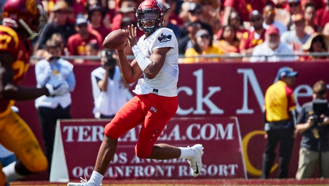 UNLV quarterback Armani Rogers is shown in the UNLV game against USC at The Coliseum in Southern California on Saturday.