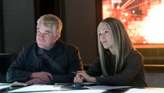 Philip Seymour Hoffman and Julianne Moore in a scene from 'The Hunger Games: Mockingjay — Part 1.'