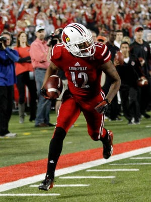 University of Louisville wide receiver Kai De La Cruz runs for a touchdown against Rutgers during the first half of play at Papa John's Cardinal Stadium on Oct. 10, 2013.