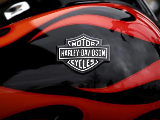 Earns Harley Davidson