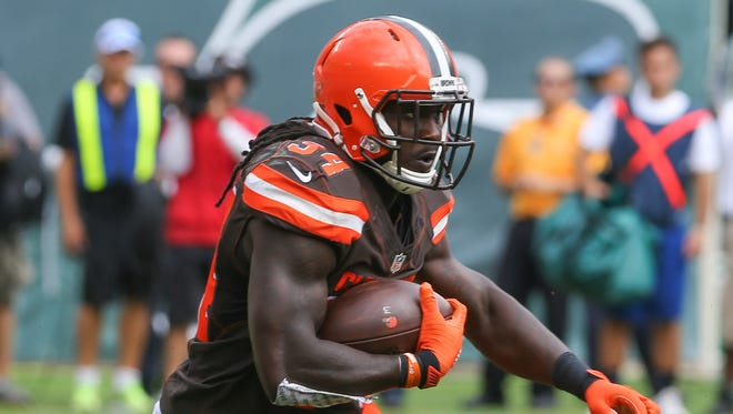 Cleveland Browns running back Isaiah Crowell (34) runs with the ball during the first half of their game against the New York Jets at MetLife Stadium.
