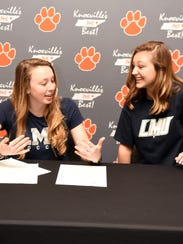 Powell High seniors Lauren Wood and Ashlyn Miller prepare to sign their letters of intent to play soccer at LMU next year.