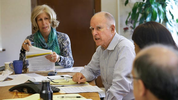 Gov. Jerry Brown discusses a bill in his Capitol office in Sacramento, Calif., Sept. 29, 2014.