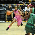 Southern Miss' Keri Jewett-Giles (3) runs the ball away from the North Texas defense on Thursday in Reed Green Coliseum.