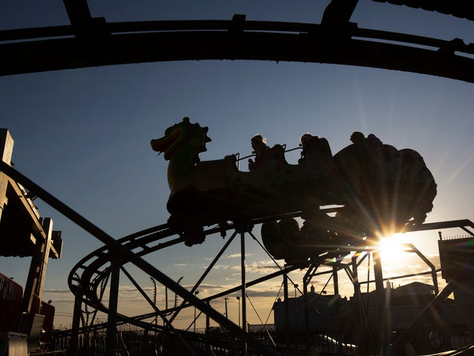 Young families enjoy the Dragon Coaster at Fantasy Island as the sun goes down on a Saturday night. Islander photos on Long Beach Island, NJ on May 30, 2013. Photo by Peter Ackerman