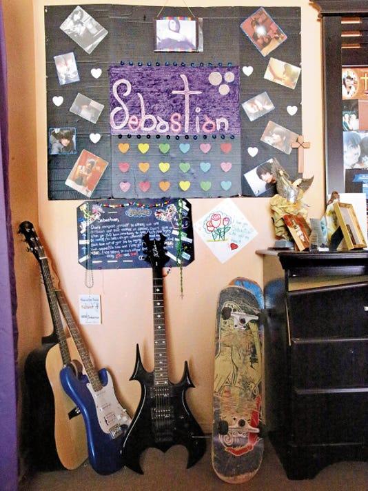 Rudy Gutierrez—El Paso Times Photographs, guitars and skatebords sit inside Sebastian Cabada's room.