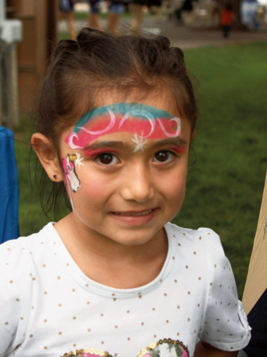 Five-year-old Tiana Ortiz is one of the many kids that got their faces painted at the Southwest Chicano Music Festival and Car Show on Saturday. Sky Klaus - Sun-News