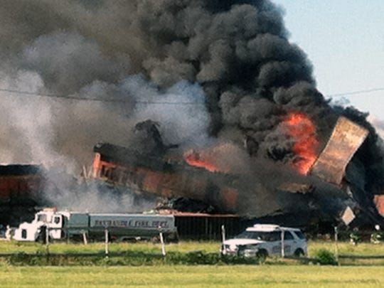 Two freight trains are on fire Tuesday, June 28, 2016, after they collided and derailed near Panhandle, Texas.