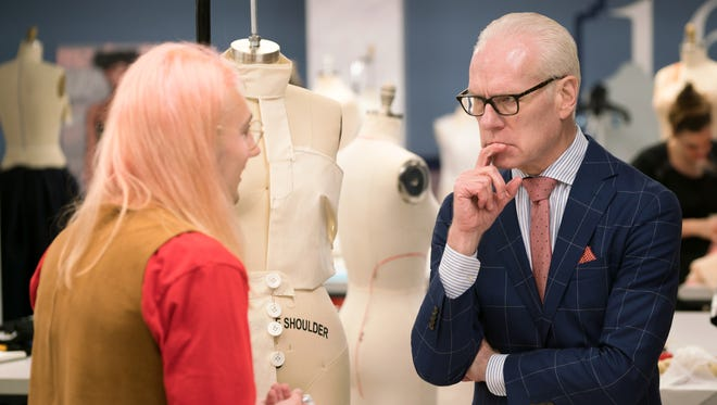 """Aaron Myers works on a design on the premiere of """"Project Runway"""" season 16."""
