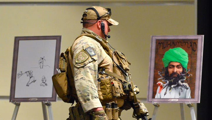 Police secure art at the Muhammad Art Exhibit and Contest