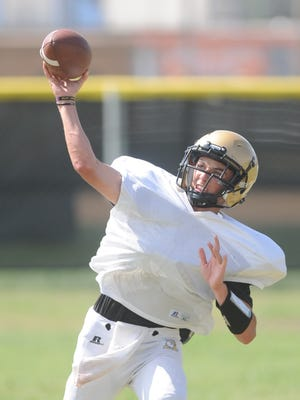Abilene High quarterback Kallin Sipe throws a pass during practice in 2017, he is one of two players vying for the Eagles starting Quarterback position.