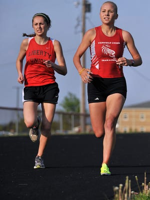 Liberty Union's Sydnee Mangette, left, makes her move to overtake Fairfield Union's Jessica Swaim during the 1,600-meter run at Tuesday's Bob Hamm Classic Invitational at Fairfield Union High School in Rushville.