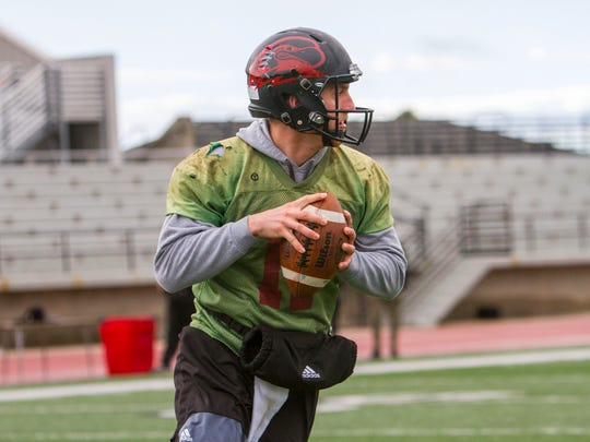 Southern Utah quarterback Aaron Zwahlen drops back to pass during spring practice March 23, 2017.