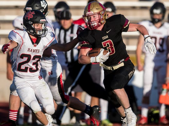 Cedar's Kolbe Meek (3) amassed over 300 total yards last Friday and was voted our Player of the Week.