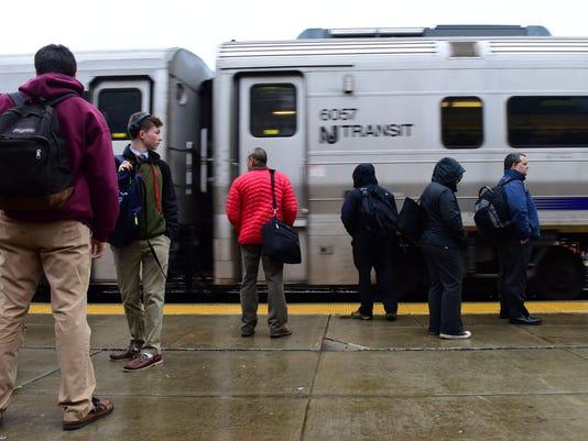 Passengers Board NJ Transit Train