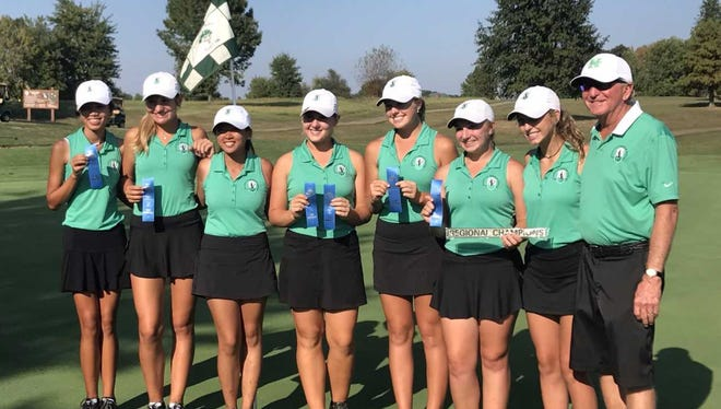 The North Huskies celebrate their fourth straight regional title Saturday at Country Oaks in Montgomery, Indiana.