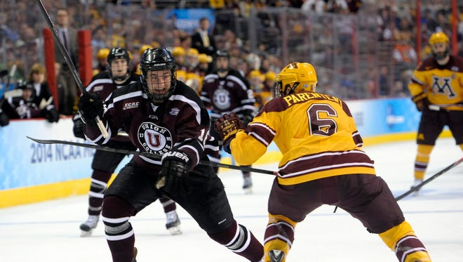 Union Dutchmen forward Kevin Sullivan (16) tries to move past Minnesota Gophers defenseman Jake Parenteau (6) during the second period in the championship game of the Frozen Four college ice hockey tournament at Wells Fargo Center.
