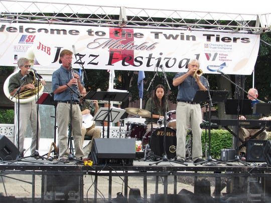 The JazzHappens Band, of Cortland, performs Saturday during the Twin Tiers Michelob Jazz Festival in Elmira's Wisner Park.