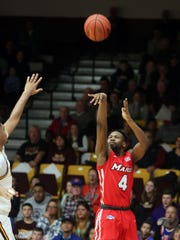 Marist College's Isaiah Lamb follows through on a jumper against Iona in New Rochelle last season.