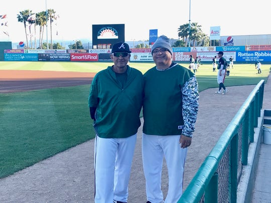 Graham Santiago said the Trojans wouldn't have had the success they did under his watch if it wasn't for the help of assistant coaches Joe Hernandez (left) and Bernie Casteneda.