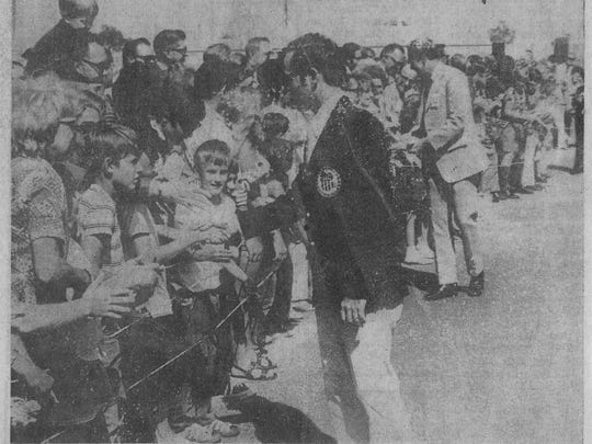 The newspaper shot  from June 29. 1972 shows New Mexico Museum of Space History Executive Director Christopher Orwoll at age 7, shaking Young's hand as he and his fellow crew members are welcomed home. Orwoll is the child looking towards the camera, his head is just above Young's hand.