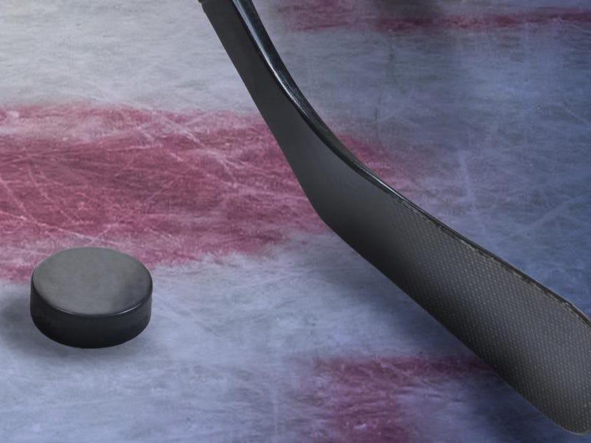Legs of hockey player.
