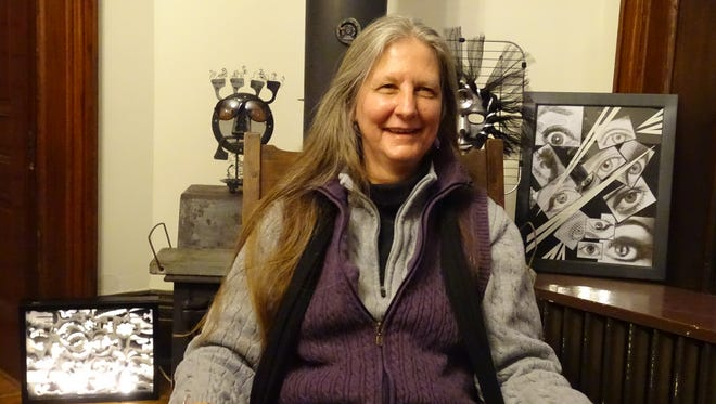 Kathy Burden, surrounded by some of her creations,  has recently devoted her life to assemblage art.