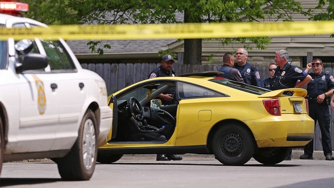 Emergency personnel surveyed the scene of a homicide about 12:30 p.m. Friday, May 13, 2016, outside a Citgo gas station at 42nd Street and Emerson Avenue.