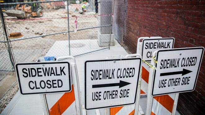A construction crew works on Walnut Street in downtown Muncie.